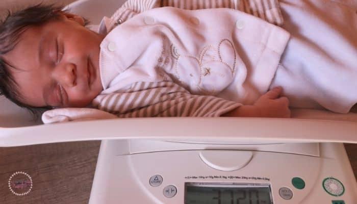 newborn on a weight machine